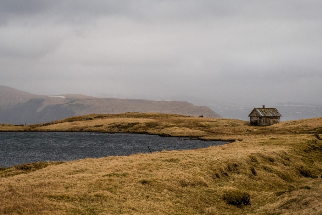A lonely cottage on a lake in Sandoy