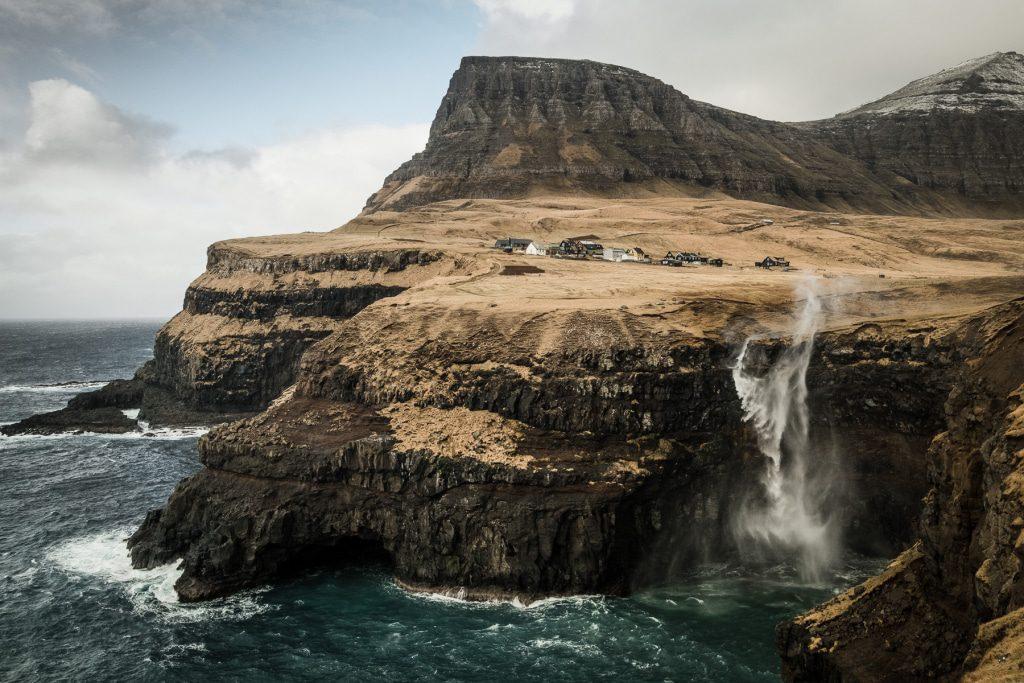 Mulafossur waterfall flowing upwards in Gasadalur